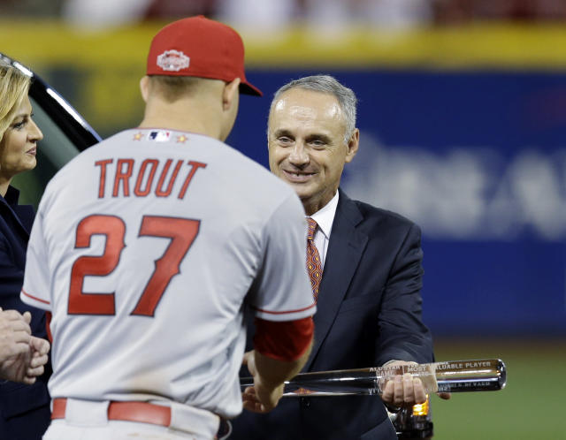 MLB Commissioner Rob Manfred presents the MVP trophy to American League's Mike Trout, of the Los Angeles Angels after the MLB All-Star baseball game, Tuesday, July 14, 2015, in Cincinnati. The American League won 6-3. (AP Photo/John Minchillo)
