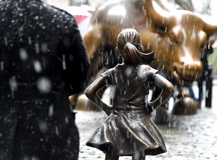 """The """" Fearless Girl """" statue on Wall Street is seen by many as a defiant symbol of women's rights under the new administration of President Donald Trump (AFP Photo/TIMOTHY A. CLARY)"""