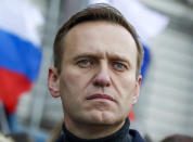 FILE - In this Saturday, Feb. 29, 2020 file photo, Russian opposition activist Alexei Navalny takes part in a march in memory of opposition leader Boris Nemtsov in Moscow, Russia. Novichok, a deadly nerve agent that has left Russian opposition politician Alexei Navalny in a coma and nearly killed a former Russian spy and his daughter in 2018, was the product of a highly secretive Soviet chemical weapons program. Just a few milligrams of the odorless liquid — the weight of a snowflake — are enough to kill a person within minutes. (AP Photo/Pavel Golovkin, File)