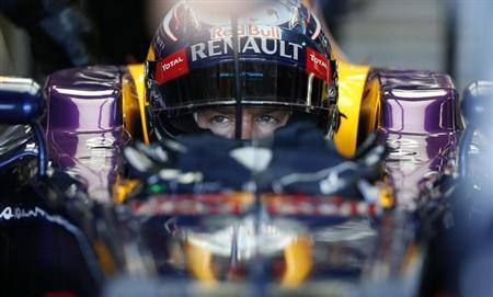Red Bull Formula One driver Sebastian Vettel of Germany sits in his car during the second practice session of the Japanese F1 Grand Prix at the Suzuka circuit October 11, 2013. REUTERS/Toru Hanai