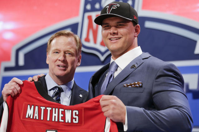 Texas A&M tackle Jake Mattews poses for photos with NFL commissioner Roger Goodell after being selected by the Atlanta Falcons as the sixth pick in the first round of the 2014 NFL Draft, Thursday, May 8, 2014, in New York. (AP Photo/Craig Ruttle)