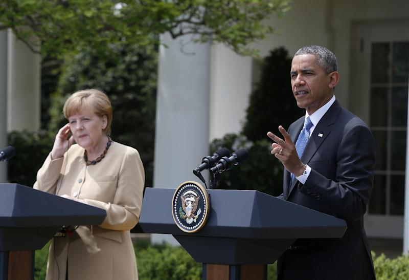 President Barack Obama and German Chancellor Angela Merkel participate in a joint news conference in the Rose Garden of the White House in Washington, Friday, May 2, 2014. Obama and Merkel are putting on a display of trans-Atlantic unity against an assertive Russia, even as sanctions imposed by Western allies seem to be doing little to change Russian President Vladimir Putin's reasoning on Ukraine. (AP Photo/Charles Dharapak)