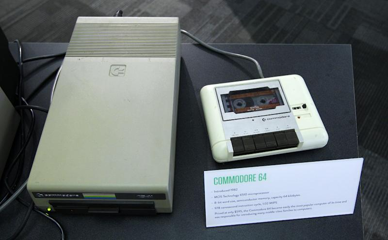 In this photo taken Oct. 30, 2012, a floppy disk drive, left, and a cassette tape data drive for a Commodore 64 personal computer are shown, at the Living Computer Museum in Seattle. For tourists with an interest in Seattle's role as a high-tech hub, there hasn't been much here to see, other than driving over to Microsoft headquarters in suburban Redmond to take pictures of a bunch of boring buildings. But Microsoft co-founder Paul Allen has just opened the Living Computer Museum, with displays of old machines _ all in working order _ along with a geeky wish list of items he'd like to add, just in case anybody out there has an old tape drive or super-computer sitting around.  (AP Photo/Ted S. Warren)