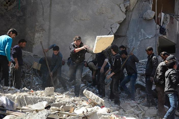 Syrians dig through the rubble of a building in search of survivors in the rebel-held area of Douma, east of the capital Damascus, following reported air strikes by regime forces on March 13, 2015 (AFP Photo/Sameer al-Doumy)