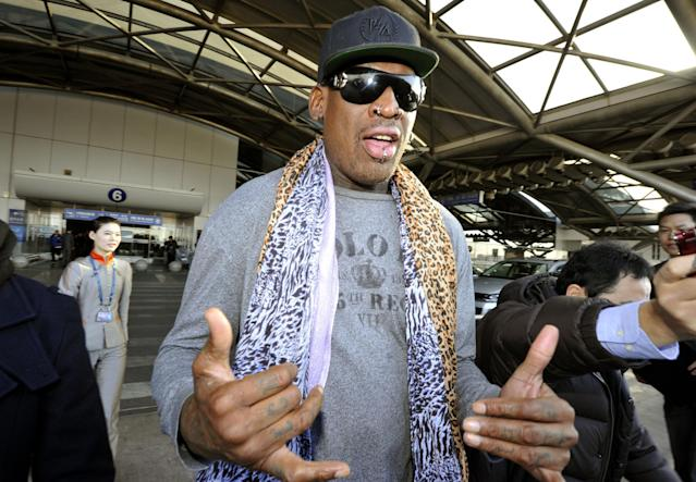 Former basketball star Dennis Rodman speaks to journalists upon arrival at the capital airport in Beijing from Pyongyang, North Korea, Monday, Dec. 23, 2013. Rodman left North Korea on Monday, but didn't answer questions from the media on whether he had met with leader Kim Jong Un on his latest visit. The two struck up a friendship when Rodman first traveled to the secretive state earlier this year. (AP Photo/Kyodo News) JAPAN OUT, CREDIT MANDATORY