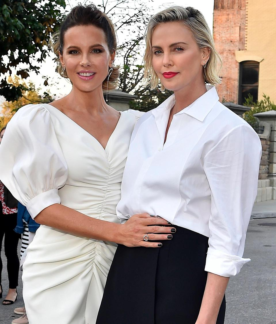 <p>Kate Beckinsale and Charlize Theron pose together at CTAOP's Night Out in Los Angeles.</p>