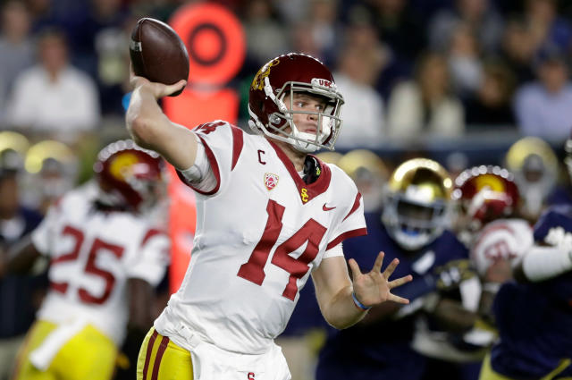 FILE - In this Oct. 21, 2017, file photo, Southern California quarterback Sam Darnold throws during the half of an NCAA football game against Notre Dame, in South Bend, Ind. Darnold is expected top be a first round pick in the NFL Draft. (AP Photo/Carlos Osorio, File)