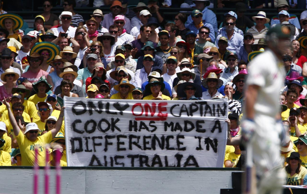 Australian supporters hold up a banner about England's captain Alastair Cook, during the first day of the fifth Ashes cricket test match between England and Australia in Sydney January 3, 2014. REUTERS/David Gray (AUSTRALIA - Tags: SPORT CRICKET)