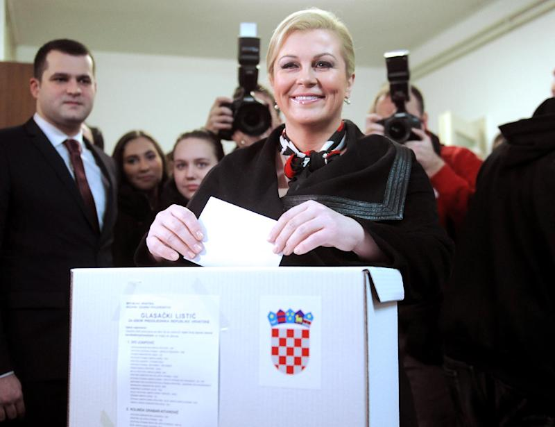 Presidential candidate of the Croatian Democratic Union (HDZ) Kolinda Grabar-Kitarovic votes at a polling station on the second run of the presidential elections in Zagreb on Jaunary 11, 2015