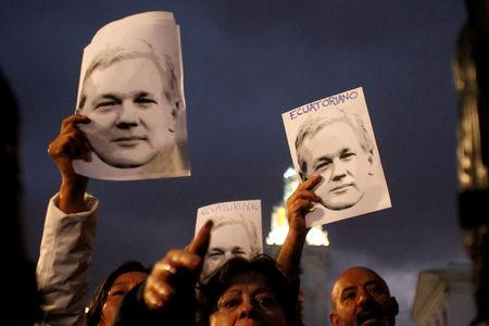 Supporters of WikiLeaks founder Assange demonstrate in front of presidential palace regarding his Ecuadorian citizenship in Quito