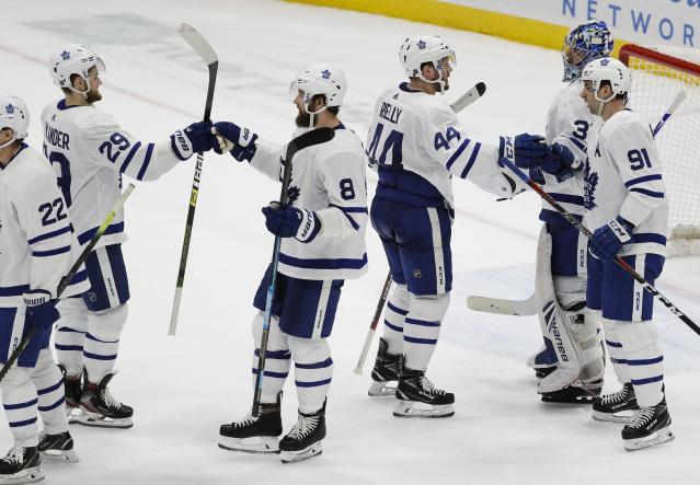 Toronto Maple Leafs goaltender Frederik Andersen (31) and John Tavares (91) celebrate with teammtes Morgan Rielly (44), Jake Muzzin (8) and William Nylander (29) after an NHL hockey game against the New York Islanders Monday, April 1, 2019, in Uniondale, N.Y. The Maple Leafs won 2-1. (AP Photo/Frank Franklin II)