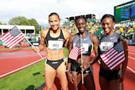 (L-R) Lolo Jones, Dawn Harper and Kellie Wells pose after qualifying for the Olympics after the women's 100 meter hurdles final during Day Two of the 2012 U.S. Olympic Track & Field Team Trials at Hayward Field on June 23, 2012 in Eugene, Oregon. (Photo by Andy Lyons/Getty Images)