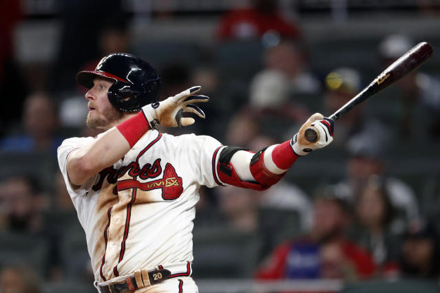 Atlanta Braves' Josh Donaldson follows through on a solo home run in the sixth inning of a baseball game against the Los Angeles Dodgers, Saturday, Aug. 17, 2019, in Atlanta. (AP Photo/John Bazemore)