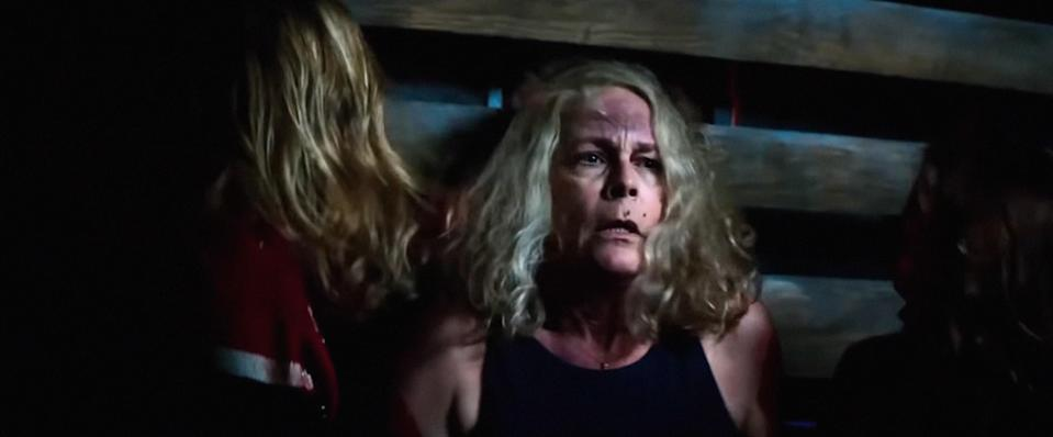 Jamie Lee Curtis up against a wall