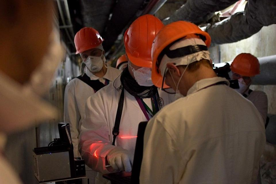 Scientists deploy the sensing equipment in reactor 4 (SSE Chernobyl NPP/PA)