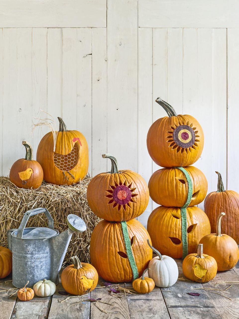 "<p>Cut a hole in the bottom of two to three pumpkins, and scoop out pulp and seeds. <a href=""http://clv.h-cdn.co/assets/downloads/1472485017_-_pumpkintemplates.pdf"" rel=""nofollow noopener"" target=""_blank"" data-ylk=""slk:Trace the templates"" class=""link rapid-noclick-resp"">Trace the templates</a> onto pumpkins. Use a knife to cut out the petals and leaves. Starting in the center of the sunflower, use hot-glue to attach different colors of twine in a spiral pattern<em>.</em> For the stalk, attach green twine in a tight zigzag pattern with hot-glue. Remove the stem from the bottom pumpkin(s); stack as shown.(No wilting sunflowers here! Use wooden skewers to secure your stack.) </p><p><a class=""link rapid-noclick-resp"" href=""https://www.amazon.com/HULISEN-Christmas-Jute-Twine-Embellishments/dp/B078J3K9HG/ref=sr_1_31_sspa?tag=syn-yahoo-20&ascsubtag=%5Bartid%7C10050.g.1350%5Bsrc%7Cyahoo-us"" rel=""nofollow noopener"" target=""_blank"" data-ylk=""slk:SHOP COLORED TWINE"">SHOP COLORED TWINE</a><br></p>"