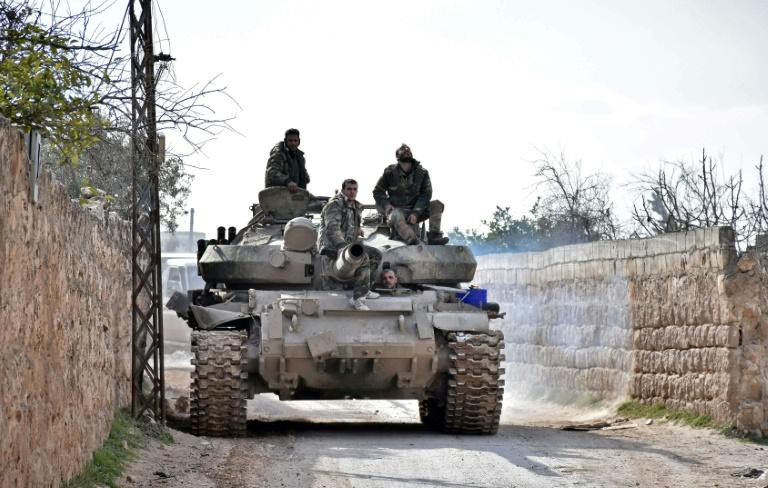Syrian troops advance through Idlib province towards Saraqeb, a strategic crossroads town long in the sights of government commanders (AFP Photo/-)