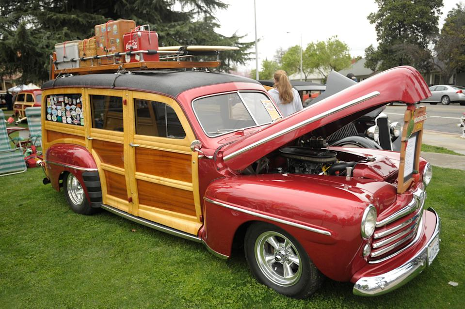 Paul Buckwalter of Palmdale shows off his 1948 Ford Woodie shown during the seventh annual Woodies in the Valley car event featuring restored and full-hot rod Woodies on the front lawn of Redwood High School in Visalia.