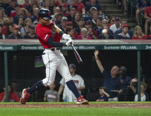 Cleveland Indians' Oscar Mercado hits a two-run home run off Philadelphia Phillies starting pitcher Jason Vargas during the second inning of a baseball game in Cleveland, Saturday, Sept. 21, 2019. (AP Photo/Phil Long)