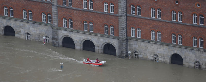 Members of the red cross make their way in a boat through the flooded old centre of Passau, southern Germany, on Tuesday, June 4, 2013. Raging waters from three rivers have flooded large parts of the southeast German city following days of heavy rainfall in central Europe. Floodwaters in Passau are receding from the highest level seen in more than five centuries but cities downstream are bracing themselves as swollen rivers sweep through southeastern Germany. At least eight people have been reported dead and nine missing in the floods in Germany, Austria, Switzerland and the Czech Republic. (AP Photo/Matthias Schrader)