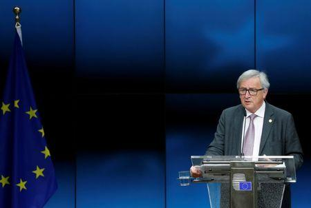 EU Commission President Juncker addresses a news conference during a EU leaders summit in Brussels