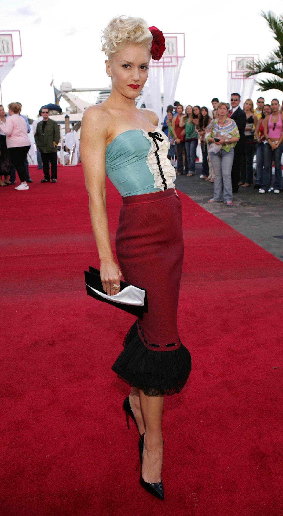 <p>Attending the 2004 MTV Video Music Awards wearing a blue tube top and red pencil skirt.</p>