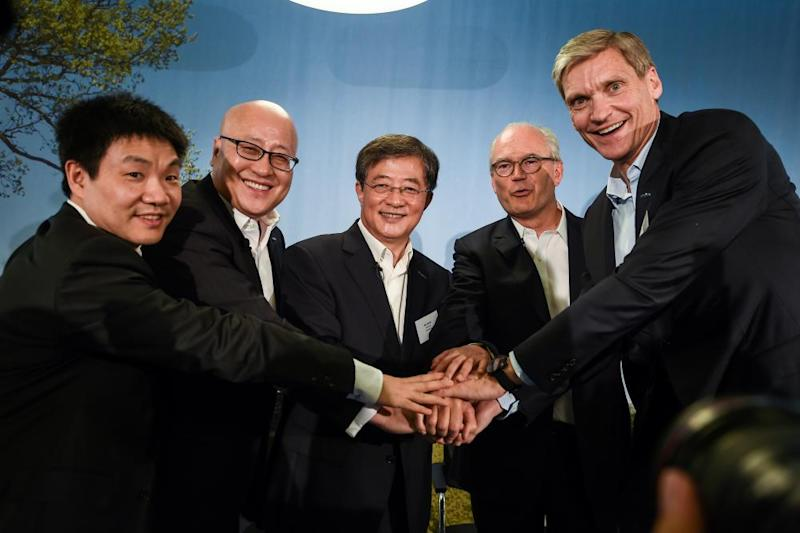 (LtoR) Syngenta future director for China Chen Hongbo, China national chemical corporation vice-president Robert Lu, its Chairman Ren Jianxin, Syngenta future vice-chairman and lead Independent director Michel Demare (2ndR) and current CEO Erik Fyrwald (R) pose after a press conference in 2017 after the company's takeover by ChemChina