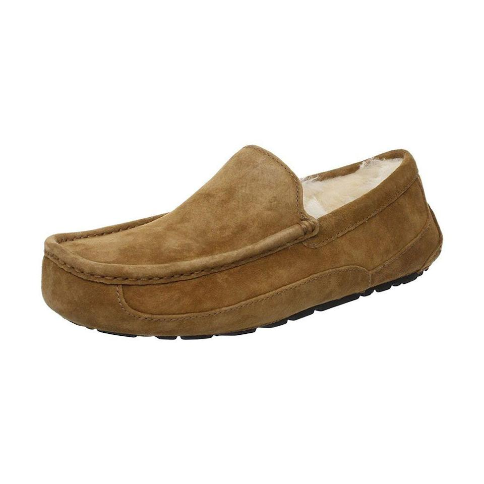 """<p><strong>UGG</strong></p><p>amazon.com</p><p><strong>$109.95</strong></p><p><a href=""""https://www.amazon.com/dp/B077JGCZFN?tag=syn-yahoo-20&ascsubtag=%5Bartid%7C2089.g.34239500%5Bsrc%7Cyahoo-us"""" rel=""""nofollow noopener"""" target=""""_blank"""" data-ylk=""""slk:Shop Now"""" class=""""link rapid-noclick-resp"""">Shop Now</a></p><p>Keep his toes warm and toasty with a smart-looking ascot slipper that'll make him feel like he's walking on a cloud. </p><p>The interior of the slipper features UGG's signature fluffy sheep wool for total comfort while lounging, while the exterior is composed of water-resistant suede and a rubber sole in case he steps outside to grab a coffee or pick up the paper. </p>"""