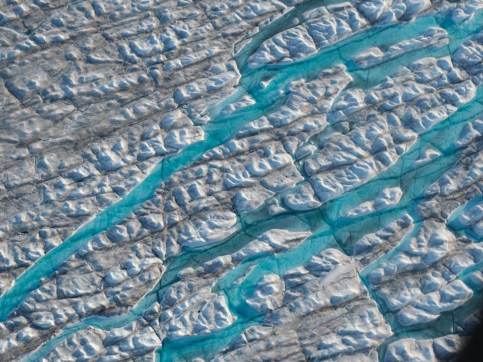 The Greenland ice sheet contains enough water to raise global sea level by seven meters - a change which would displace millions of people (Sean Gallup/Getty Images)