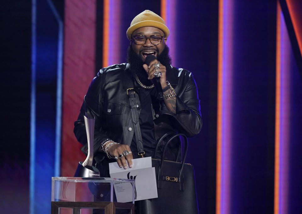Blanco Brown presents the award for group of the year at the 56th annual Academy of Country Music Awards on Sunday, April 18, 2021, at the Grand Ole Opry in Nashville, Tenn. (AP Photo/Mark Humphrey)