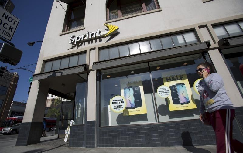A person walks by a Sprint store in Pasadena