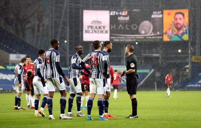 West Brom players complain to referee Craig Pawson about the penalty award before seeing it overturned