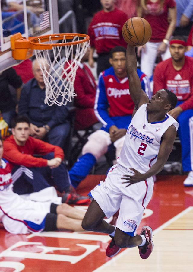 Los Angeles Clippers guard Darren Collison (2) goes up for a lay up against Golden State Warriors during the first half of Game 7 of a first-round NBA basketball playoff series, Saturday, May 3, 2014, in Los Angeles. (AP Photo/Ringo H.W. Chiu)