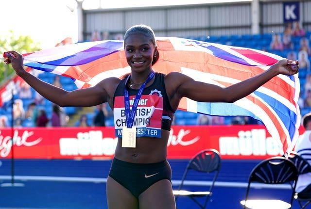 Dina Asher-Smith celebrates after winning the women's 100m final at the Muller British Athletics Championships