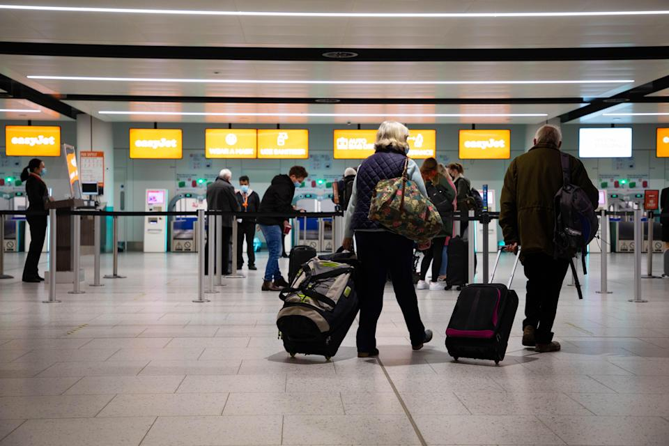 <p>All aboard: Passengers check in for the first holiday and leisure flights from Gatwick Airport, as easyJet relaunches flights from the UK to green-list destinations </p> ((David Parry/PA))