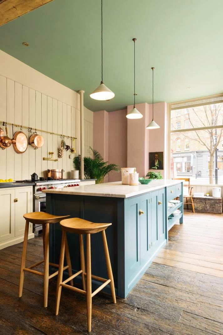 <p>Why settle for one color when you could have two? Just make sure you choose two complimentary colors so nothing clashes, like the muted mint green and dusty rose pink in this deVOL kitchen. The wood elements and traditional design balance things out nicely, too. </p>