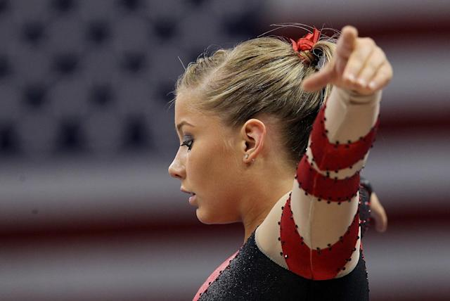 Shawn Johnson stretches before the Senior Women's competition on day four of the Visa Gymnastics Championships at Xcel Energy Center on August 20, 2011 in St Paul, Minnesota.