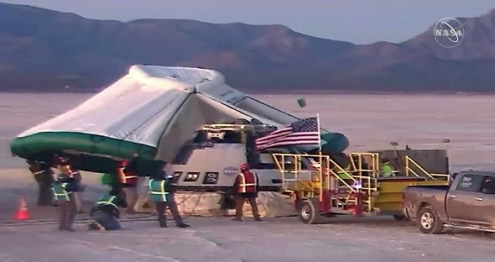 FILE PHOTO: Boeing Starliner space capsule checked after landing at White Sands