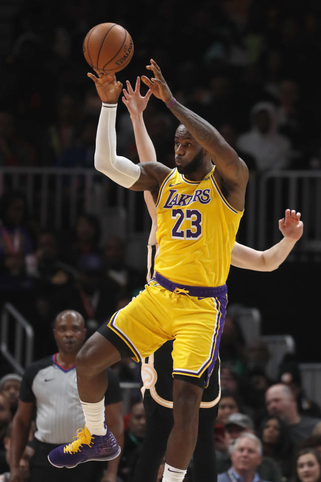 Los Angeles Lakers forward LeBron James (23) passes the ball in the second half of an NBA basketball game against the Atlanta Hawks, Sunday, Dec. 15, 2019, in Atlanta. (AP Photo/John Bazemore)