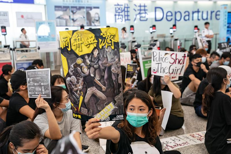 "HONG KONG, CHINA - AUGUST 13: Protesters occupy the departure hall of the Hong Kong International Airport during a demonstration on August 13, 2019 in Hong Kong, China. Pro-democracy protesters have continued rallies on the streets of Hong Kong against a controversial extradition bill since 9 June as the city plunged into crisis after waves of demonstrations and several violent clashes. Hong Kong's Chief Executive Carrie Lam apologized for introducing the bill and declared it ""dead"", however protesters have continued to draw large crowds with demands for Lam's resignation and completely withdraw the bill. (Photo by Anthony Kwan/Getty Images)"