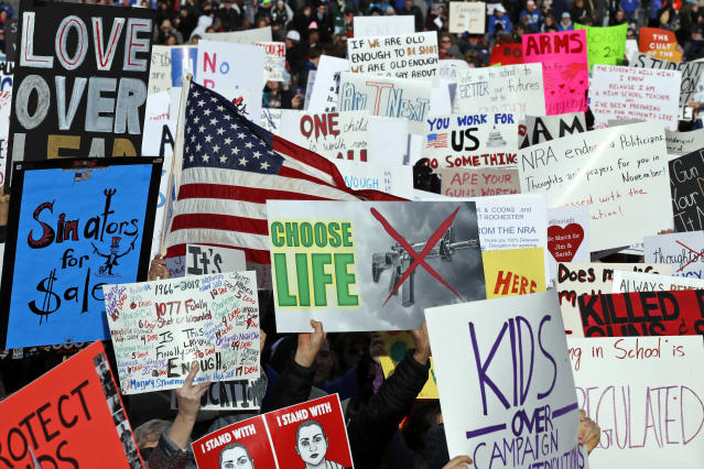 <p>Crowds hold signs on Pennsylvania Avenue before the March for Our Lives rally in support of stricter gun control on March 24, 2018, in Washington. (Photo: AP/Alex Brandon) </p>