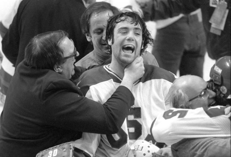 "*ATTENTION AP SPORTS PHOTO DESK, EMBARGOED UNTIL 12:01AM ON FRIDAY, DECEMBER 21, 2020* In this Feb. 22, 1980, photo, Team USA goaltender Jim Craig got a hug from goalie coach Warren Strelow in the moments after defeating the Soviet Union during the medal-round of the Winter Olympics in Lake Placid, N.Y. Tourism is a $1.2 billion industry in the Lake Placid region, much of it still fueled by the memory of the U.S. hockey team beating the Soviet Union as the ""Miracle on Ice"" highlight of the 1980 Olympic Games. (Tom Sweeney/Star Tribune via AP)"