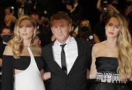 Katheryn Winnick, from left, Sean Penn, and Dylan Penn pose for photographers upon arrival at the premiere of the film 'Flag Day' at the 74th international film festival, Cannes, southern France, Saturday, July 10, 2021. (Photo by Vianney Le Caer/Invision/AP)