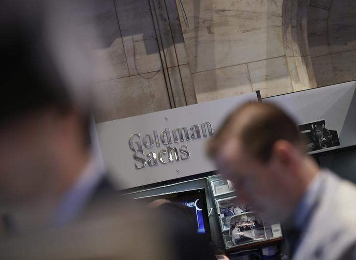 A Goldman Sachs sign is seen over the company's trading stall on the floor at the New York Stock Exchange