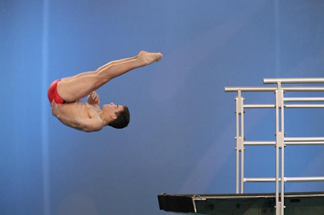 SYDNEY - SEPTEMBER 29: Alexandre Despatie of Canada performs in the Men's 10m Platform Semo-Final during the Sydney 2000 Olympic Games on September 29,2000 at the Sydney International Aquatic Centre in Sydney, Australia. (Photo by: Gary M. Prior/Getty Images)