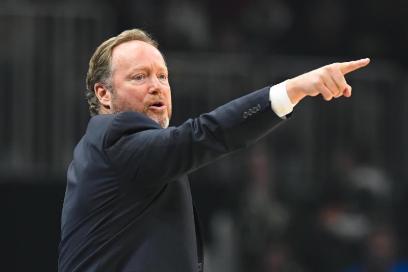 Milwaukee Bucks coach Mike Budenholzer gestures from the sideline during the second half of an NBA basketball game against the Atlanta Hawks, Friday, Dec. 27, 2019, in Atlanta. (AP Photo/John Amis)