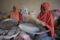 In this Saturday Aug. 6, 2016, photo, women sort raw frankincense gum in Burao, Somaliland, a breakaway region of Somalia. These last wild frankincense forests on Earth are under threat as prices have shot up in recent years with the global appetite for essential oils, and overharvesting has led to the trees dying off faster than they can replenish, putting the ancient resin trade at risk. (AP Photo/Jason Patinkin)