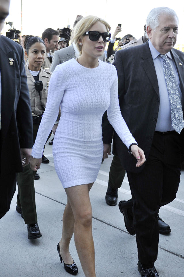"LiLo caused a stir in 2011 when, back to blond, she arrived at court in a ""Basic Instinct""-style outfit."