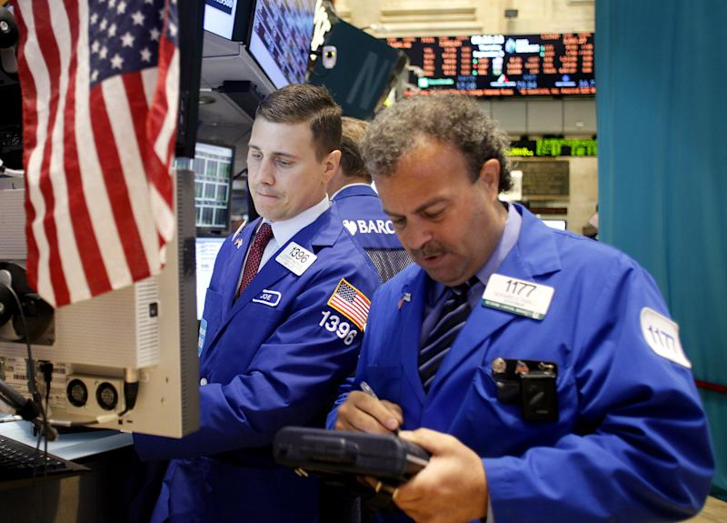 Specialist Joseph P. Mastrolia, left, and Broker Gerard E. Farco, right, work the trading floor of the New York Stock Exchang after the opening bell, Thursday, Sept.. 6, 2012 (AP Photo/David Karp)