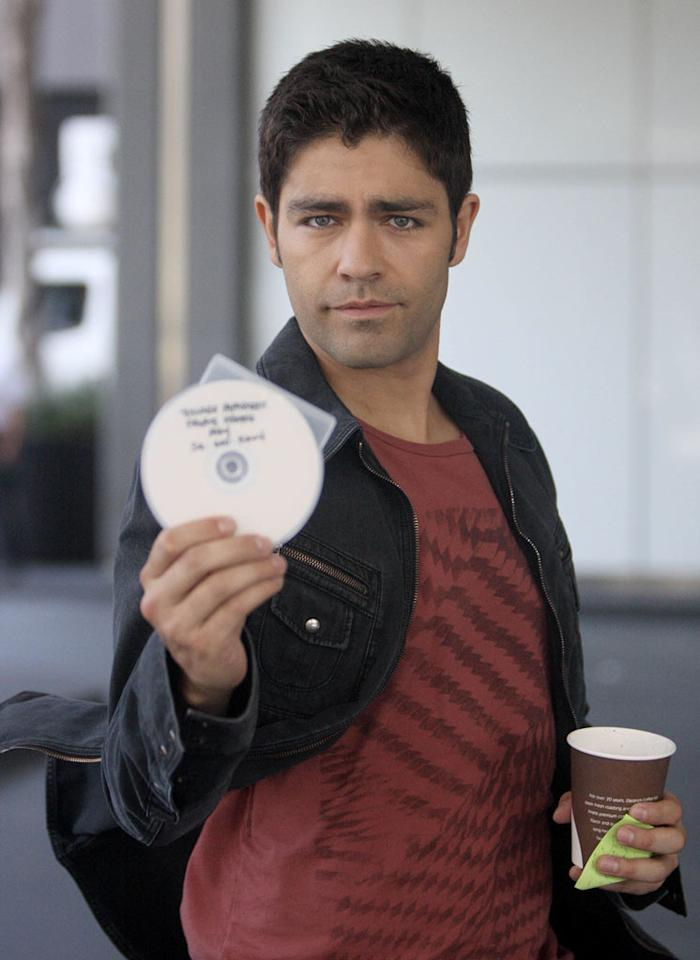 """Entourage's"" leading man, Adrian Grenier, struck a playful pose. Don't you think he looks like a younger version of Stamos?! Who do you think is hotter? London Entertainment/<a href=""http://www.splashnewsonline.com"" target=""new"">Splash News</a> - May 7, 2010"
